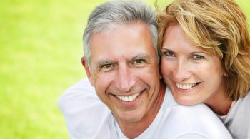 Close-up portrait of a happy mature couple smiling and embracing.